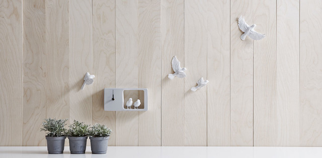 Immagine di orologio da parete di design Sparrow clock grigio.