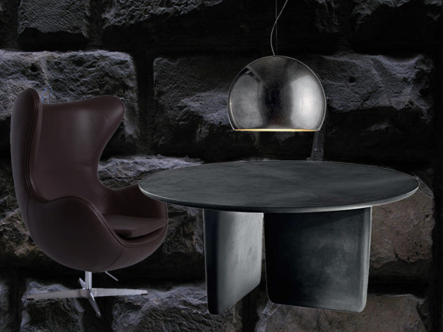 Tre pezzi must nell'arredo neo dark: tavolo, poltrona e lampada.